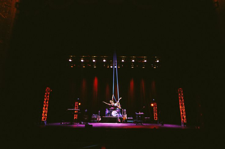 A unique wedding at The Fillmore Theater in Detroit, Michigan featuring aerialists, circus performers, and an amazing band! Detroit Flyhouse definitely added a unique experience to this wedding!