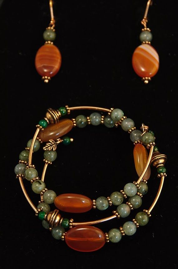 Wrap around bracelet made with labradorite and carnelian beads accented by brass spacers and beads with tiny leaf pendants at the ends. Matching earrings make this pair a fancier set of jewelry for any occasions.