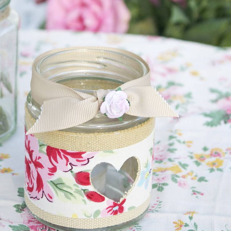 A simply beautiful and stylish recycled jam jar tea light holder. Covered with fabric and vintage book paper and with your personalisation. £10.00