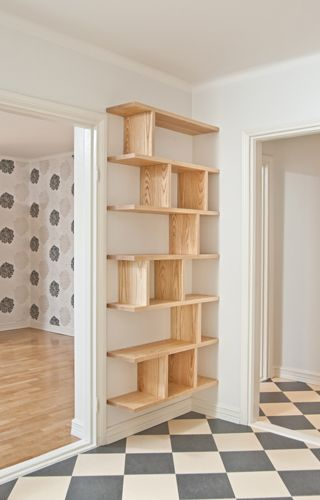 cool built in shelves - what if we did this to make a pantry or storage on the wall across from the refrigerator?