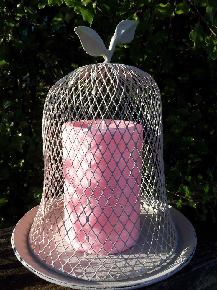 Sweet Pea Vanilla - Medium pink pillar displayed in powder coated wire dome.