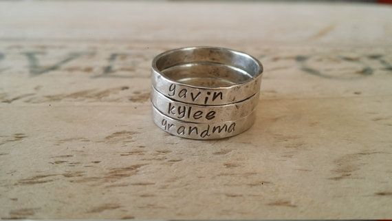 Check out this item in my Etsy shop https://www.etsy.com/ca/listing/292427559/name-stacking-rings-name-rings