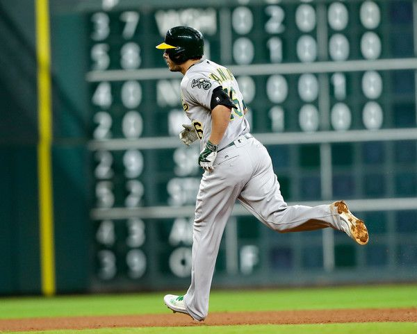 Danny Valencia Photos - Danny Valencia #26 of the Oakland Athletics hits a home run in the sixth inning against the Houston Astros at Minute Maid Park on June 4, 2016 in Houston, Texas. - Oakland Athletics v Houston Astros