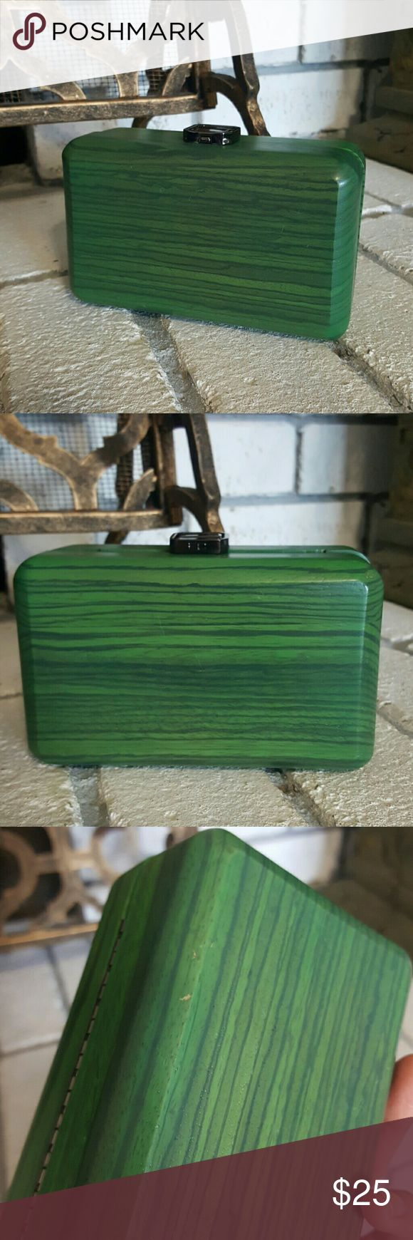 French Connection Wood Clutch Bag Super unique French Connection handbag.. Clutch or shoulder bag.. Made of 100% green wood.. Never used.. Has some minor chips on  outside  and the top clasp shuts awkwardly but still remains closed. Purchased from Nordstrom. French Connection Bags Clutches & Wristlets