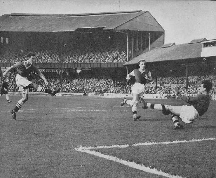 12th October 1957. Chelsea youngster Jimmy Greaves rifles the ball past Aston Villa goalkeeper Nigel Sims, at Stamford Bridge.