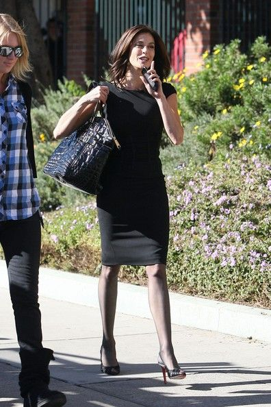 Teri Hatcher Lookbook: Teri Hatcher wearing Oversized Tote (1 of 13). Teri looked chic and classic in an all-black ensemble, while carrying an oversized, black patent leather, embossed tote bag.