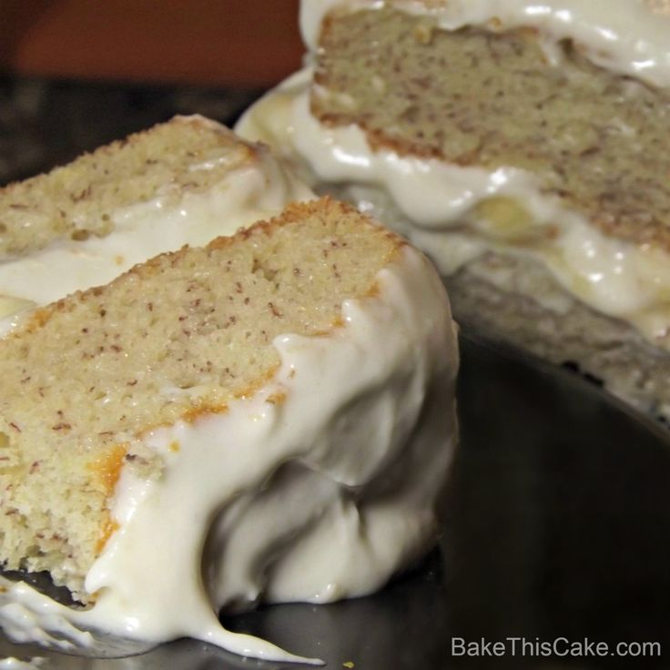 http://bakethiscake.com/2012/06/27/banana-frosting-recipe/#  Banana Layer Cake on black plate with cake in BG BakeThisCake