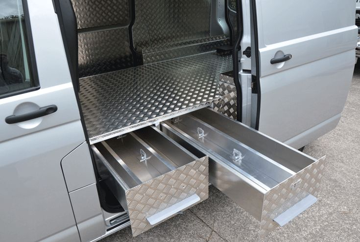 Pull out drawers under tiny house floring for storage and insulation.   VW Transporter Farriers Floor Drawer System.