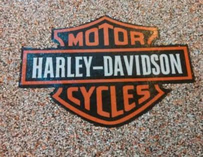 Harley Davidson logo with the Harley color blend.  Can also add silver chips for the Harley chrome blend.  No sealer
