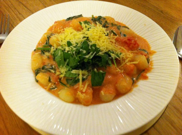 Gnocchi in spinach, tomato and marscapone! Don't forget the garlic and basil.