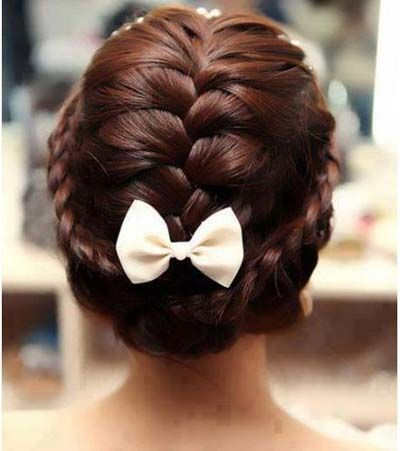 Braided hair crown with French braid down middle, all pinned with a bow