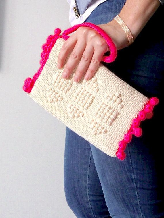 A truly unique piece, this lovely clutch bag will add fun to any outfit. It is a foldover style in ecru cotton, with a zip closure and neon pink
