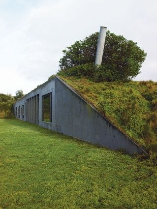 """Begun in 1983, the Phillip Island House by Denton Corker Marshall rejects nostalgia in residential architecture, instead pursuing monumentality and restraint. Considered """"ruthlessly elegant"""" when completed, this concrete bunker remains one of a kind in Australia"""