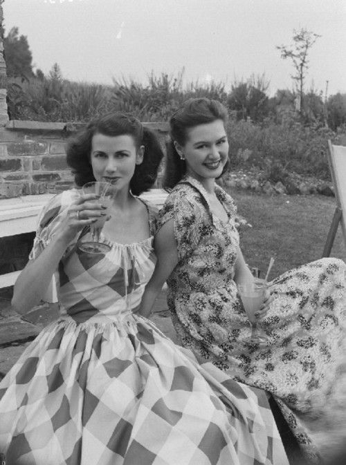 Stylish girlfriends at a garden party, c. 1951. The one on the right looks like my mother!