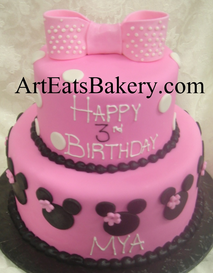 two tier pink fondant creative unique girls birthday cake design idea with black minnie mouse heads