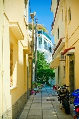 typical narrow street somewhere in Kos Island, yellow and blue!
