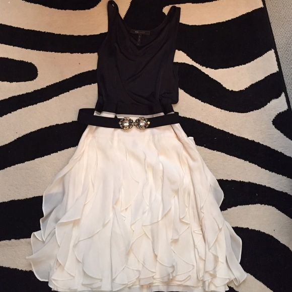 BCBG Max Azria Black and White Spring Dress 100% Polyester. Size 02. BCBG Spring Colletion. Fitted black top, flowy white bottom with a jeweled belt. Worn only once. Perfect for any upscale occasion. BCBGMaxAzria Dresses Midi
