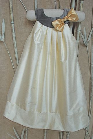 La Petite Couture's luxury dress- Ivory silk dupioni with a soft charcoal velour colored collar and a golden satin bow at neck. The ivory shantung dress pleats out in a perfect full a-line silhouette.