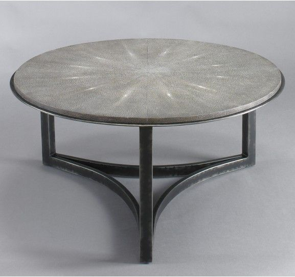Get two of these tables for your living room as an alternative to a large coffee table.