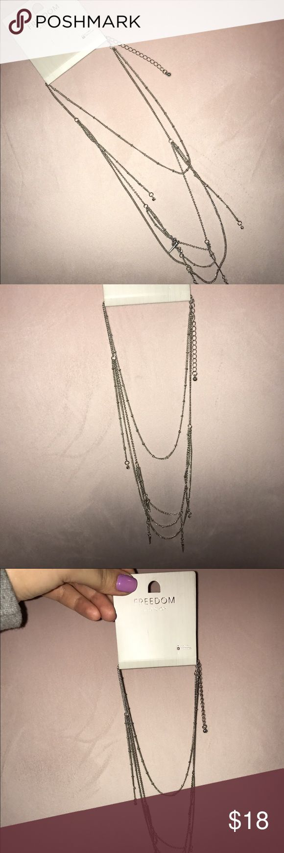 Topshop necklace NWT Freedom of Topshop silver necklace new with tags. In original packaging. Makes any casual outfit look amazing ✨ has adjustable clasp in the back and was bought from an original Topshop location Topshop Jewelry Necklaces