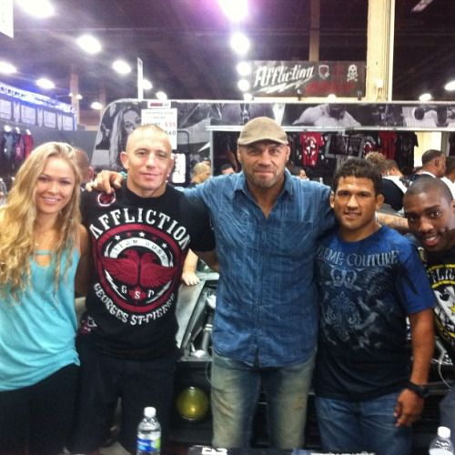 Ronda Rousey with some legends of MMA at the UFC Expo