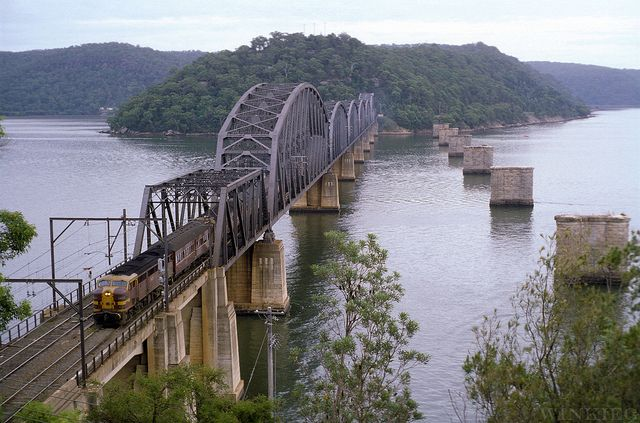 """Heading for Sydney, 4480 glides over the """"new"""" Hawkesbury River bridge near Brooklyn with an up pass. The original 1889 structure was replaced in 1946 due to structural faults. 1979."""