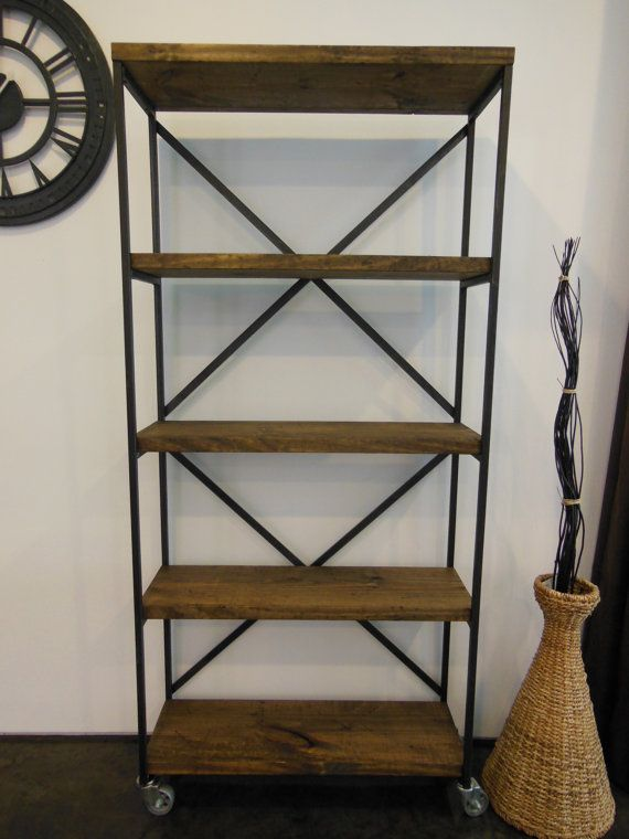 This beautiful Bookcase is 78 tall 36 wide 13 deep. Distressed wood shelves (1-1/2 thick). 3 cast iron casters. The very top shelf is 14-1/2.
