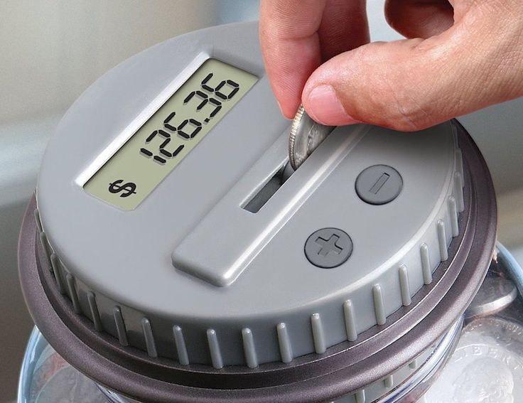 This digital coin bank keeps track of change on its digital LCD screen and updates your total each time you put in a coin.