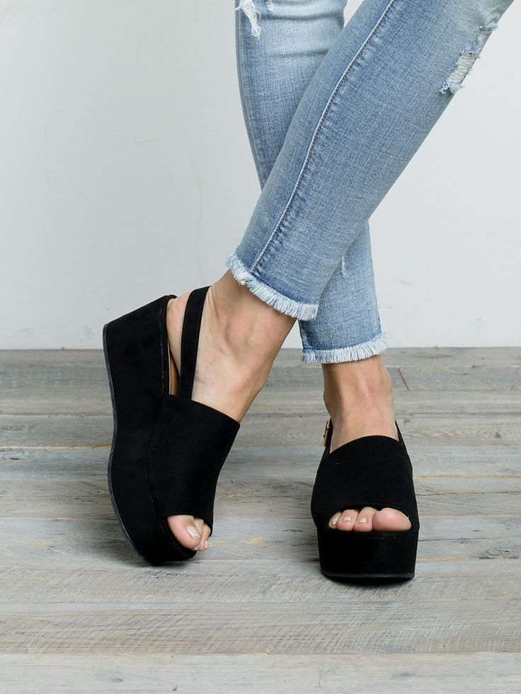 "Vegan suede platform wedge with open toe , and sling back strap with buckle closure. 2 ½"" Heel Height Manmade Materials"
