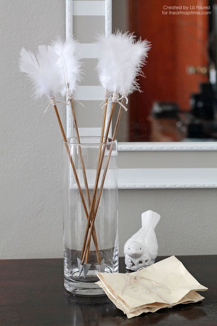 DIY Feathered Arrow Valentine Decor. Would be great with a little cut out heart for the arrowhead too.