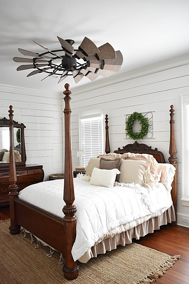 Farmhouse Bedroom With Original Shiplap Walls And Windmill Ceiling