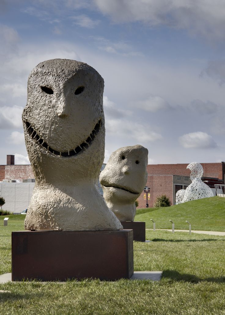 These childlike and somewhat awkward faces are two from a series of twelve sculptures titled MOONRISE. Each sculpture depicts an exaggerated expression and is named after a month of the year. East. january has a mischievous appearance with its toothy grin, squinty eyes, and pointy nose.   / Ugo Rondinone / MOONRISE. east. january, 2005 / Photo Credit: © Cameron Campbell 2009