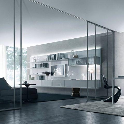 door detail by rimadesio aluminium frame in titanium finish and transparent glass