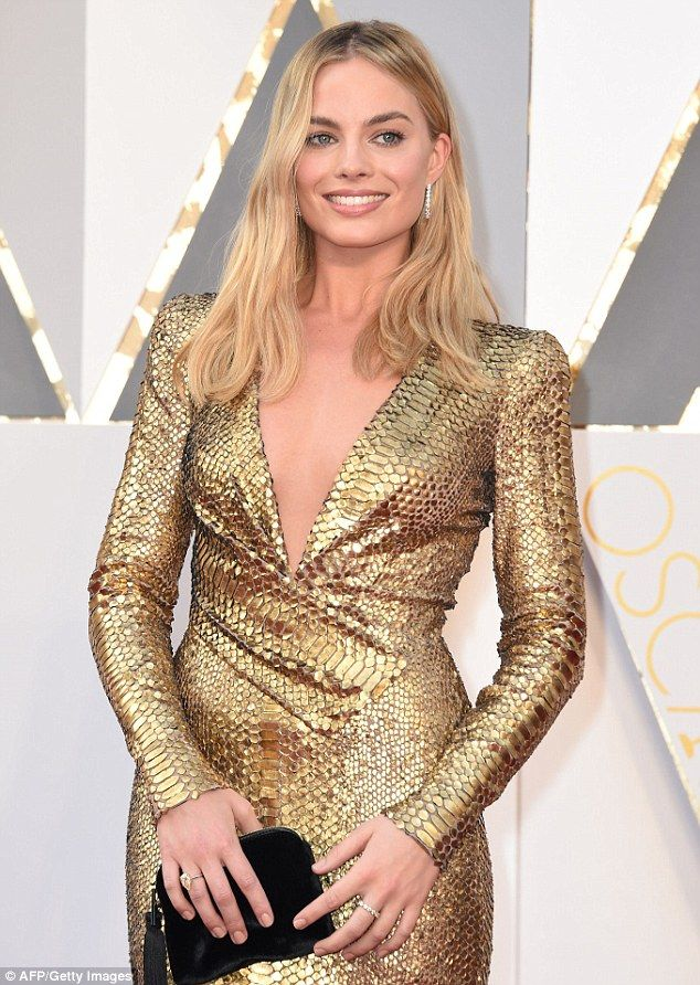 Attention to detail: Margot sported some glimmering earrings and rings...