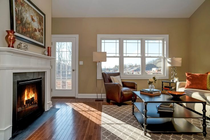 Cozy fireplace warms the living room in our Bradley model.