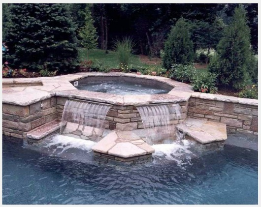Hot Tub Waterfall with benches beneath