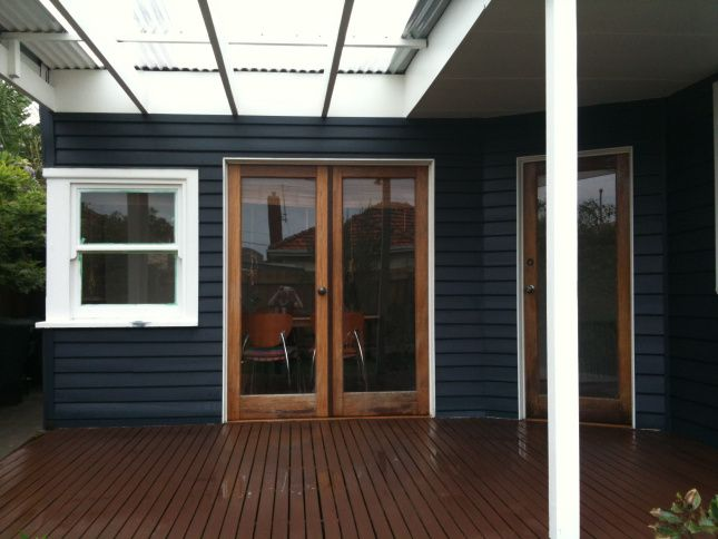 Dark blue - really dark blue - exterior with white and timber trim