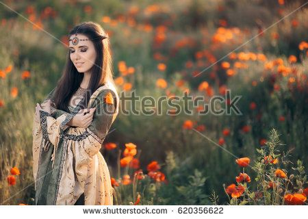 Beautiful Medieval Queen Daydreaming in Nature - Princess with eyes closed in a field of poppies