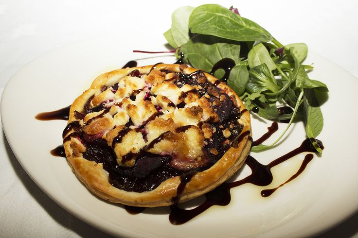 Goat's cheese, beetroot & red onion tart (v) with puff pastry, crisp salad and balsamic glaze