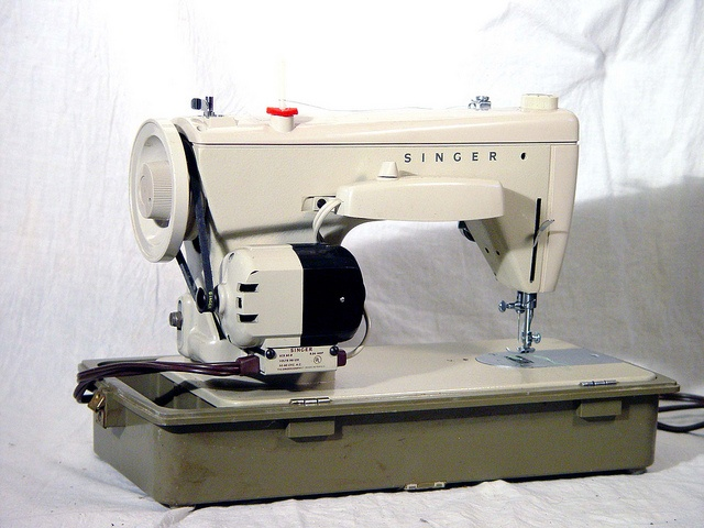 A Revolution in Sewing! The Singer Fashion Mate, the sewing machine wonder of the century!    This Mad Men Era vintage machine circa 1964 from Surrender Dorothy has been Refurbished and Rebuilt in our workshop from the inside out. She runs just like th