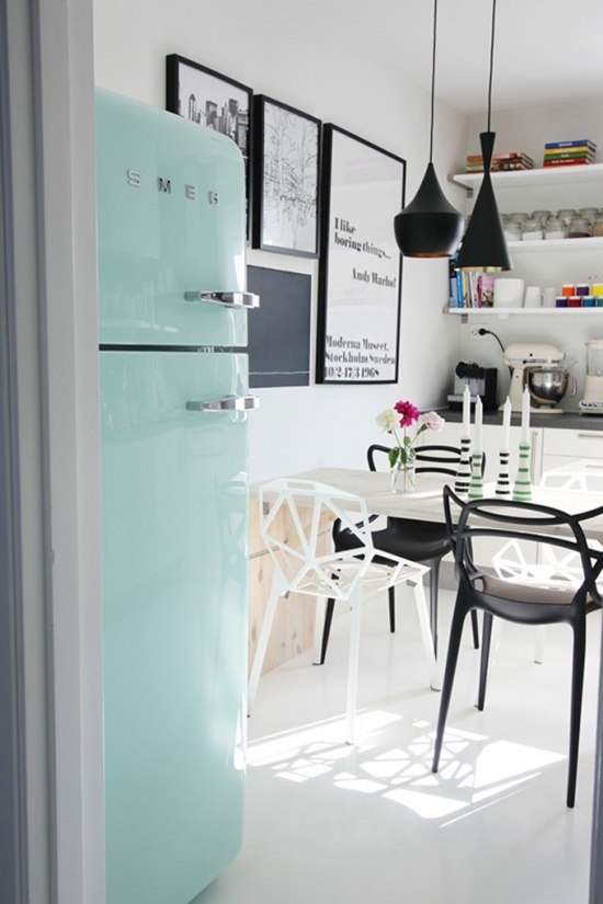 black, white, pops of color. very cool kitchen.