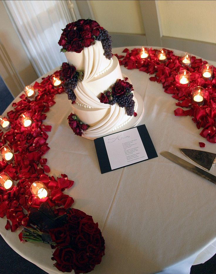 wedding cake table with petals