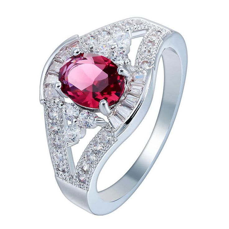 ANOTHER SHOT OF THE PINK RUBY AND SAPPHIRE DIAMOND ENGAGEMENT RING. SET IN PLATINUM.