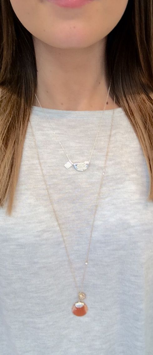 FROM TOP TO BOTTOM, By Charlotte: lotus and little Buddha necklace, silver $139.00. Heavenly lotus necklace, silver $249.00