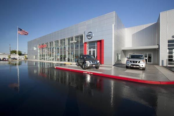 """""""A full service automobile dealership, Maita Nissan features a 46,400 s.f. 2 story building on a 4 1/2 acre site, enclosed service drive up and new vehicle delivery areas, an automatic car wash bay, express lube bays and 24 vehicle service bays. The exterior features metal wall panels."""
