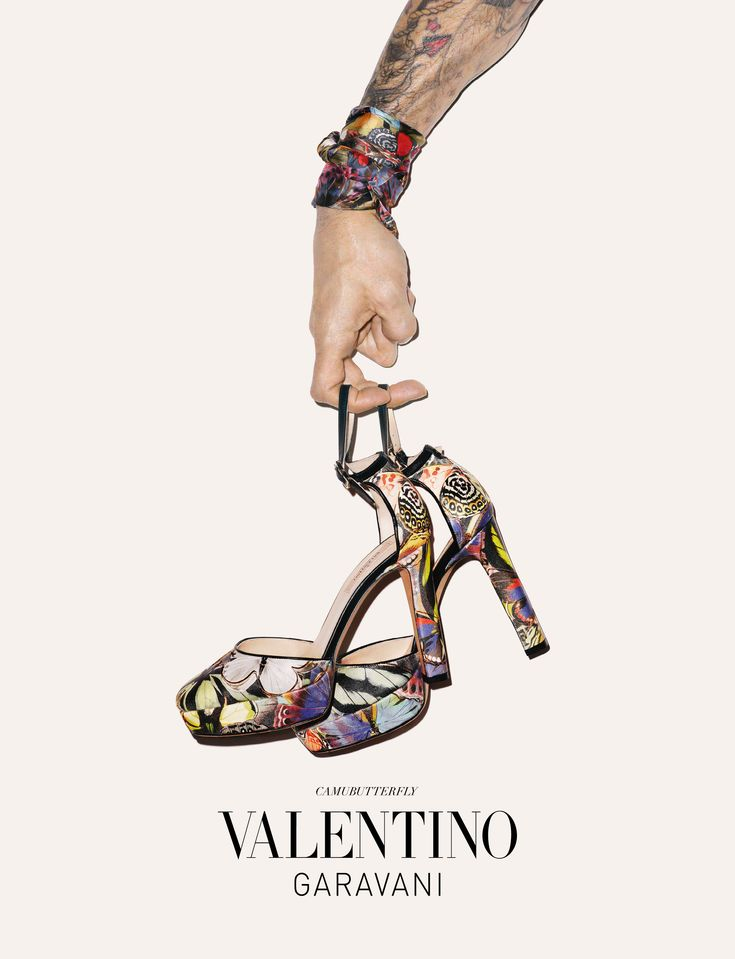 this ad is very editorial it has the shoes and the designer and thats it but like something you would see in a magazine.