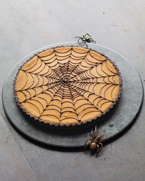 pumpkin chocolate-spiderweb tart... I don't know about the recipe, but love the idea for decorating for Halloween.  Maybe cheesecake?