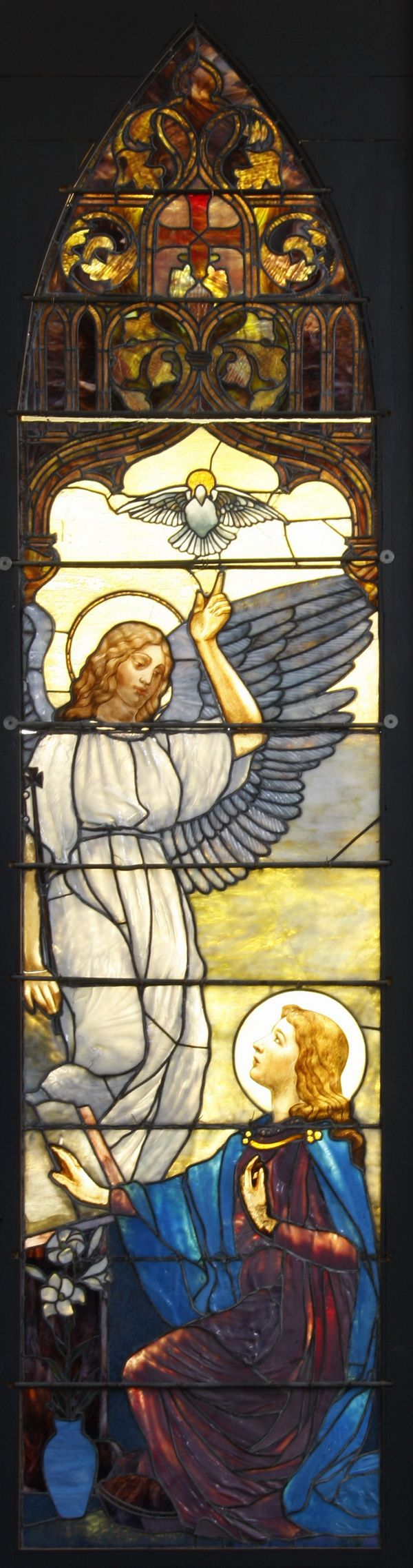 "Early 20th century Tiffany stained glass window depicting the Archangel Gabriel visiting the Virgin Mary, 132""h x 32""w (dimensions do not include wood frame). Originally installed, circa 1924, in the Church of the Resurrection in Oswego, NY, the windows are listed on p. 217 of J. Alastair Duncan's book titled ""Tiffany Windows,""."