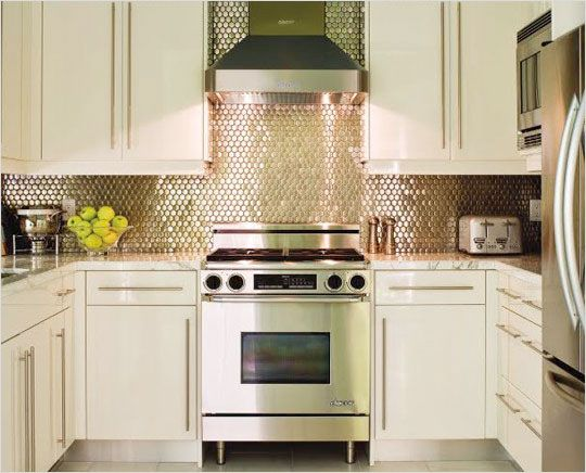 A reflective backsplash is a nice small kitchen idea for Nice kitchen designs photo