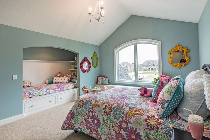 Transitional Kids Bedroom with Cathedral ceiling, Built-in bookshelf, Pendant Light, Window seat, Carpet